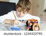tired little kid boy at home...   Shutterstock . vector #1234323790