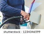 refueling car at gas station....   Shutterstock . vector #1234346599