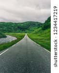 road surrounded with mountains... | Shutterstock . vector #1234417219