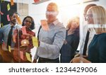 mature manager pointing at... | Shutterstock . vector #1234429006