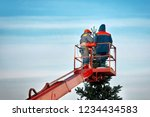 municipal workers on the crane... | Shutterstock . vector #1234434583