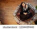 pretty indian girl in black... | Shutterstock . vector #1234439440
