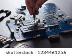technician plug in cpu... | Shutterstock . vector #1234461256