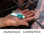 man's hand holds a sachet with... | Shutterstock . vector #1234467013