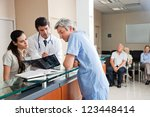 doctors reviewing x ray at... | Shutterstock . vector #123448414