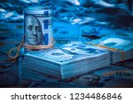 a roll of dollars with a pack... | Shutterstock . vector #1234486846