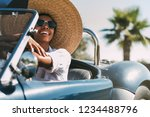 black woman driving a vintage... | Shutterstock . vector #1234488796