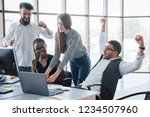 young employees sitting in the... | Shutterstock . vector #1234507960