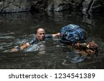 a man is swimming in a river... | Shutterstock . vector #1234541389