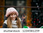 excited blonde girl wearing... | Shutterstock . vector #1234581259