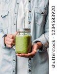female hands holding glass jar... | Shutterstock . vector #1234583920