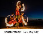 three strong men juggling fire... | Shutterstock . vector #123459439
