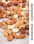 various nuts and almonds... | Shutterstock . vector #1234600240
