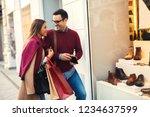 beautiful young couple enjoying ... | Shutterstock . vector #1234637599