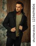 handsome man in black jacket | Shutterstock . vector #1234694806
