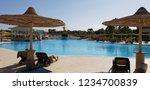 poolside in tourist village in... | Shutterstock . vector #1234700839