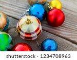 christmas baubles on wooden...   Shutterstock . vector #1234708963