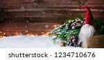 cute christmas gnome is sitting ... | Shutterstock . vector #1234710676