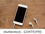 white mobile phone earphone... | Shutterstock . vector #1234751950