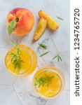 homemade peach juice with ice... | Shutterstock . vector #1234765720