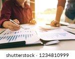 two businessman team calculate... | Shutterstock . vector #1234810999