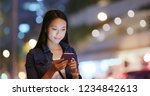 woman use of mobile phone in... | Shutterstock . vector #1234842613
