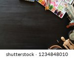 dark wooden workspace of artist ...   Shutterstock . vector #1234848010