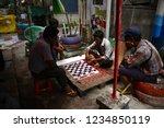 a back alley of yangon  myanmar.... | Shutterstock . vector #1234850119
