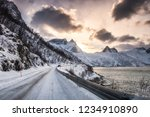 country road in snow valley on... | Shutterstock . vector #1234910890