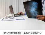 doctor diagnose and analyze on... | Shutterstock . vector #1234935340