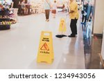cleaning in the mall a warning... | Shutterstock . vector #1234943056