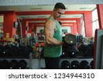 young sexy male bodybuilder...   Shutterstock . vector #1234944310