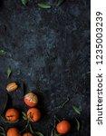 fresh mandarin oranges with... | Shutterstock . vector #1235003239