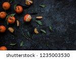 fresh mandarins with leaves on... | Shutterstock . vector #1235003530