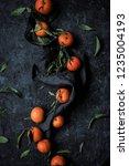 top view of ripe tangerines... | Shutterstock . vector #1235004193