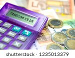 euro banknotes  calculator and... | Shutterstock . vector #1235013379