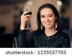 woman toasting with red wine at ... | Shutterstock . vector #1235037703