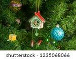wooden toy clock with pendulum... | Shutterstock . vector #1235068066
