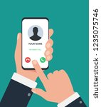 the hand holds the smartphone... | Shutterstock .eps vector #1235075746