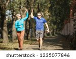 image of sporting man and woman ... | Shutterstock . vector #1235077846