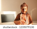 buddha statue inside the house... | Shutterstock . vector #1235079130