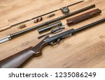 disassembled shotgun parts and... | Shutterstock . vector #1235086249