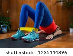 woman exercising with rubber... | Shutterstock . vector #1235114896