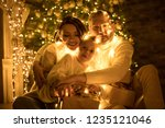 happy family wrapped in a... | Shutterstock . vector #1235121046