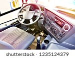 driver seat and steering wheel... | Shutterstock . vector #1235124379