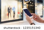 woman hands holding and using... | Shutterstock . vector #1235151340