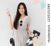 young beautiful asian woman... | Shutterstock . vector #1235151589