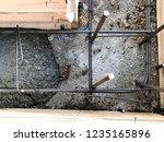 builders pour concrete into the ...   Shutterstock . vector #1235165896