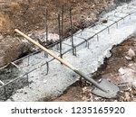 builders pour concrete into the ...   Shutterstock . vector #1235165920