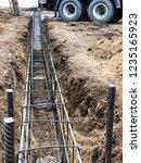 builders pour concrete into the ...   Shutterstock . vector #1235165923